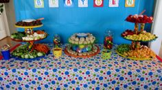 Our grandsons 1st birthday party theme was balls, using primary colors.  This is the food table.  My daughter-in-law and I used primary colored plastic trays and bowls.  What colors we could not find we used plastic spray paint on the backs of the clear trays or bowls.  We filled containers with gumballs, plastic balls and any other round primary colored candies we could find, to elevate our trays. FYI - Party City has a section of candy that is color coordinated.