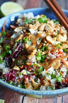 Thai Cashew Coconut Rice with Ginger Peanut Dressing.  Vegan and oil-free!  This rice salad is seriously addictive and always a huge hit at potlucks!