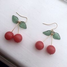 Adorable and dainty tiny cherry drop earrings!! These are so precious and fun. Brand new and never worn, modeled for size comparison :) 3 day USPS shipping! - tags: green dangly earrings hoops nwot jewelry lolita vibes art hoe fruit aa cute handmade vintage thrift cheap korean fashion unif