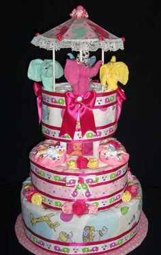 Elephant Carousel Diaper Cake with 120 Pampers Swaddlers created by Diaper Cakes by Diana
