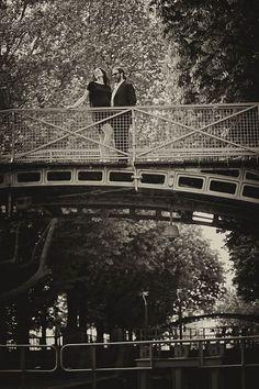 Couple Portrait session in Paris with weddingLight shot at the quai de Jemappes bridge overlooking the famous hotel du Nord