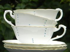 Unmarked (no backstamp) Tea Cup and Saucer. Crisp White with small blue dots on a wide mouthed cup with a raised handle. Set is in excellent condition, No chips, cracks, crazing or stains.Cute Set!Cup measures 2.25 inches tall and 3.75 inches wide.
