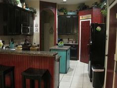 Kitchen redo. Old colors were brown and black. Needed color so added red & teel.