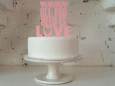 All You Need Is Love - Cake Topper. £16.99, via Etsy.