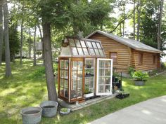 Greenhouse made from old cabin windows.