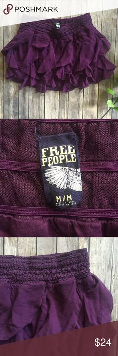 Free People Purple Mini Layered Skirt  Great used condition. Beautiful horizontally layered purple skirt by Free People. Perfect with a slimming top!  Free People Skirts Mini