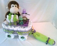 """Diaper Cakes + wagon + Babyshower + Gifts Happy Halloween Diaper Wagon ~Great Treat for all your Ghouls & Goblins! Filled with Plenty of Treats for the Mommies-to-be & their little monsters! Can be made in any colors, theme or holidays! Order yours Now! """"like"""" us on FB! #CornerStorkBakery Baby Shower"""
