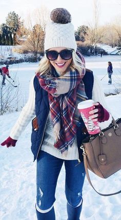 #winter #fashion / White Beanie / Navy Puff Vest / Cream Knit / Ripped Skinny Jeans