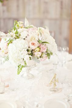 Lush and lovely centerpieces. Photography by glassjarphotography.com, Floral Design by floraloccasions.com