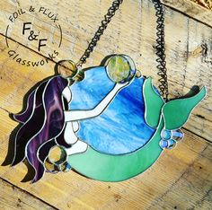 Stained glass mermaid playing with bubbles, created by Foil&Flux Glassworks. 2017 #StainedGlassMermaid