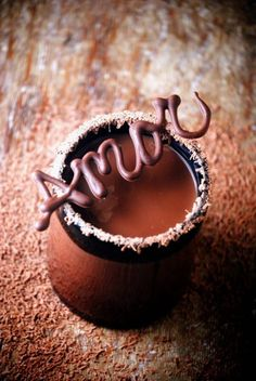 I'm not exactly sure what this is, but it looks like hot chocolate in a chocolate cup with a chocolate decoration. If it is it would be perfect for the coffee/ sweet treat station we are thinking of adding to our reception. <3