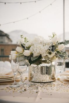 Love the idea of mercury glass centerpiece containers with mostly white and green floral and a touch of blue