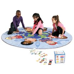 Children of the World Carpet and Dice - A Distinctive and highly visual circular carpet that depicts children of different ethnicities standing on landmarks of the world. Designed to stimulate discussion into culture and ethnicity which will give children an enhanced knowledge of the world and the differences in peoples teachings & beliefs.