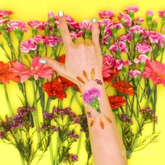 Learn how to make temporary flower tattoos with this beauty video DIY tutorial.