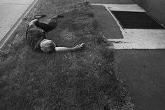Sleeping man on grass, Detroit, 1972 Dave Jordano