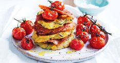 These golden zucchini and corn fritters, stacked with crispy bacon and served with oven roasted tomatoes, are great for breakfast, lunch or dinner. Zucchini Corn Fritters, Bacon Zucchini, Crispy Bacon Recipe, Bacon Recipes For Dinner, Coles Recipe, Oven Roasted Tomatoes, Cooking For A Crowd, Easy Cooking, Quick Easy Meals