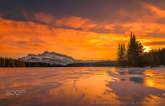 Sunset in full display - Sunset in full display at Two Jack Lake Second shot of my Two Jack Lake series around 10 to 15 minutes apart  https://en.wikipedia.org/wiki/Banff_National_Park  Banff National Park /ˈbanff/ is Canada's oldest national park, established in 1885 in the Rocky Mountains. The park, located 110–180 kilometres (68–112 mi) west of Calgary in the province of Alberta, encompasses 6,641 square kilometres (2,564 sq mi)[2] of mountainous terrain, with numerous glaciers and ice…