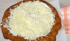 This is Langos. It is a fried dough served with three different types of toppings, cheese, sour cream, and garlic. You can also have them plain if you like. Hungarian Desserts, Hungarian Cuisine, National Dish, Street Food, Sour Cream, Bakery, Food And Drink, Appetizers, Yummy Food