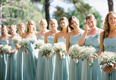 Dusty shale chiffon bridesmaid gowns with baby's breath bouquets.