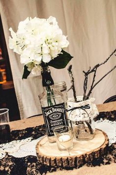 Ahah looking for wedding ideas and this comes up, haha ;D Jack Daniels Hydrangeas Rustic wedding -MJD Jack Daniels Party, Jack Daniels Wedding, Festa Jack Daniels, Jack Daniels Bottle, Jack Daniels Drinks, Bottle Centerpieces, Rustic Wedding Centerpieces, Wedding Table, Wedding Rustic