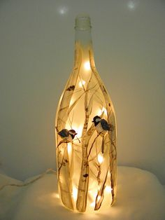 I have used a recycled frosted wine bottles and transformed it into a UNIQUE LIGHT. This light features birch trees and chickadees. It was hand painted on the bottle by myself here in my North Woods Shop.  Special paint specific to glass was used on this item. The bottle is 13 tall and has 35 white lights wound into the interior with the cord exiting the bottle through a hole in the back side. The cord is white.  This item will spruce up a window, mantle, bookshelf, or counter top and make a…