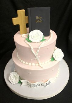 The Bible and rosary beads are a great topper to this simple but elegant Communion Cake.