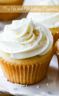 White Wedding Cupcakes...Tender and moist homemade vanilla almond cupcakes topped with creamy white chocolate frosting. A truly elegant treat for the most special day.
