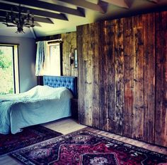 Scaffolding Board Clad Wall and Window's, Plus fitted wardrobes, all reclaimed and natural finish.
