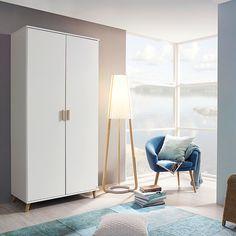 Mit diesem Drehtürenschrank setzen Sie in Ihrem Schlafzimmer moderne Akzente und schaffen Stauraum. Das Modell FALUN besteht aus Holzdekor, die Front ist in schlichtem Weiß gehalten. So fügt sich das Modell gekonnt in Ihr bestehendes Ambiente ein und strahlt helle Freundlichkeit aus. Mit den Maßen ca. 92 x 203 x 53 cm (B x H x T) ist diese Ausführung mit zwei Drehtüren ausgestattet. Diese werden mit eschefarbenen Stangengriffen geöffnet. Armoire D'angle, Tall Cabinet Storage, Divider, Room, Furniture, Home Decor, Orange, Products, Environment