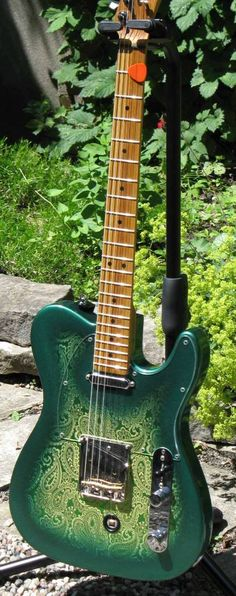 Green paisley - I can't confirm if this is actually a Fender.