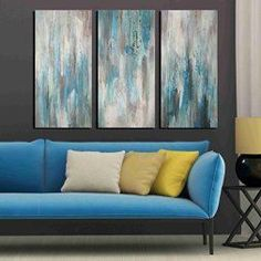 Blue wall art is pretty, trendy and stylish.  It can be found in homes all over the world.  Blue home wall art décor works well for almost any room of the home especially the  living room, bedroom and even offices.   Blue wall art is truly some of the best decorative accents I have seen.      ARTLAND Hand-painted 'Sea of Clarity' Oil Painting Gallery-wrapped Canvas Art Set 3-piece (16x32inches x3)