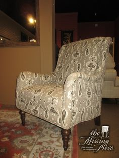 "Contemporary style modified wingback chair with low sloped arms in a taupe and gray patterned upholstery on dark wood legs. What stunning look! Would be beautiful in a living room or a bedroom. 33""W x 31""D x 44""H."