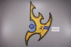 Quick post before class. I made up this pattern of the Protoss symbol for my bestie's boyfriend. I'd done two versions, one with the black inside 'lines' and one without, and she liked this one...