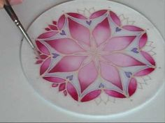 Good to watch how she patiently builds up blends and gives dyes time to do their work/spread. SILK PAINTING -- Mandala painting 2 - YouTube