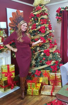 Shirley Bovshow wears a form fitting 3/4 length sleeve for the holiday season. Burgandy,stretch ultra suede fabric with princess seams and band waist. Great for hourglass figures!!