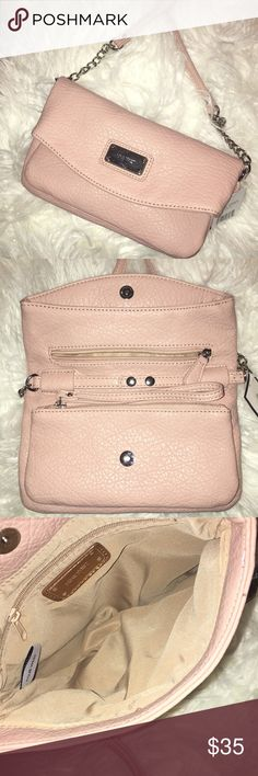 NWT Nine West Pale Pink Crossbody purse! Brand new/ never used. The long strap can be detached so that the bag can also be worn as a wristlet/ wallet/ small clutch. The accents on the purse are silver (chain/ buttons). There are two smaller zipper compartments and one larger compartment that is secured by snapping the inside buttons together. Within the larger compartment is a smaller zipper pocket for anything you'd want to keep secure (phone/keys). Great for a summer or spring outfit to…