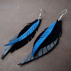 My etsy shop has lots of earrings like these ones.  Buy now and I will custom make some for you in the colours of your choice! Leather Feather Long Earrings in Blue and Black