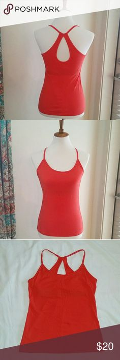 Patagonia racer back tank Beautiful red coral athletic tank from Patagonia. Organic cotton blend with built in bra, keyhole back, and stitched logo. So cute and comfortable. Excellent condition. I think I only wore this once. Size small, runs TTS.   Check out my closet for more great items! But dle discount available. Patagonia Tops Tank Tops