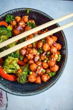 General Tso's Chickpeas With Soy Sauce, Mirin, Chickpeas, Vegetable Broth, Tomato Paste, Natural Peanut Butter, Soy Sauce, Rice Vinegar, Coconut Sugar, Chili Sauce, Sriracha, Toasted Sesame Oil, Prepared Mustard, Corn Starch, Ground Black Pepper, Neutral Oil, Onions, Broccoli, Red Bell Pepper, Minced Ginger, Garlic, Sauce, Chickpeas, Sesame Seeds, Purple Onion, Green Onions, Cooked Rice