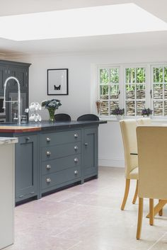 Sustainable Kitchens - A Grand Design in Malmesbury. The centre island with it's triple material Welsh Slate, Marble and Oak worktop really is the piece-de-resistance of this shaker style kitchen. Not to mention the enormous tap flowing over the top of the elegant undermounted sink, this island steals all the attention. It is painted in Farrow & Ball Down Pipe.The enormous skylight directly over the centre island illuminates and provides a naturally lit daytime workspace.