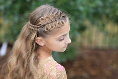 Easy video tutorial for Prim's Bow Braid Tieback from    #HungerGames movie #CatchingFire! {Linda Flowers, the lead stylist on the movie franchise, invited me on set and used a few of my hairstyles for inspiration!}