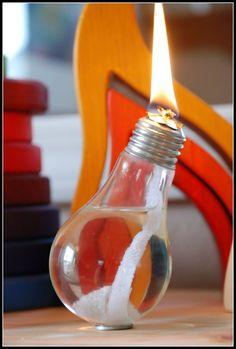 Candele ad acqua come realizzare candele olio acqua con pietre decori fai da te video foto materiale occorrente per fare candele barattoli lampadine riciclo