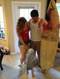 Family Halloween costume '12. this is 10 kinds of adorable! I could be the lifeguard, Dustin could be the injured surfer, and Colton could be the shark! :)