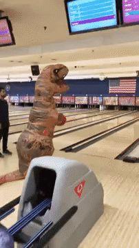 images.halloweencostumes.com blog 962 trex-bowling.gif