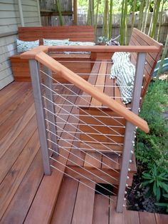 Contemporary Deck with Tigerwood decking boards, Atlantis Rail Systems - Stainless Steel Railing, Fence