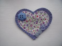 Heart shaped felt brooch with decorative buttons by Fabrilushus, £4.50
