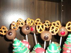 Christmas cake pops.  I used mini pretzels for the  reindeer antlers and drew the eyes and mouth with an edible ink marker.  For the Christmas trees, I hand formed the Christmas tree pops and swirled white chocolate for the garland and dusted with sanding sugar.