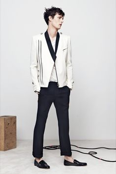 SPRING 2014 MENSWEAR Balmain /  Serge Gainsbourg is the renewable resource of French menswear, an ever-charged battery of inspiration. For Spring, Olivier Rousteing availed himself of the volts. He loved Gainsbourg's shuffling way with a dancer's shoe, the thrown-on jacket, the essential Frenchness of it all.