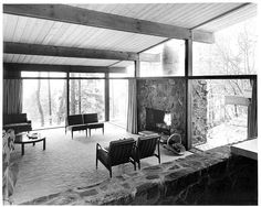 1956 house living room - glass walls stone fireplace