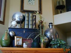 If the ceilings are high enough... Rustic pieces arranged on top of an armoire. ~s